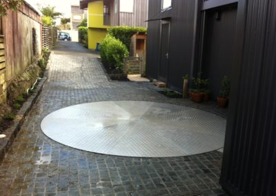 This very tight driveway required a turntable for compliance.